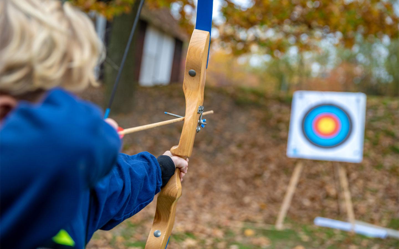 Child trying archery