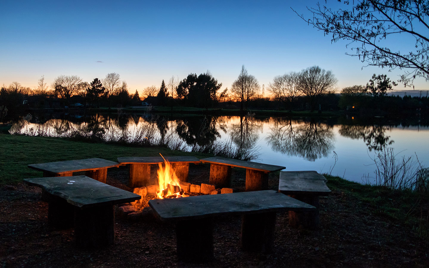 Log fire at sunset at Log House Holidays in the Cotswolds