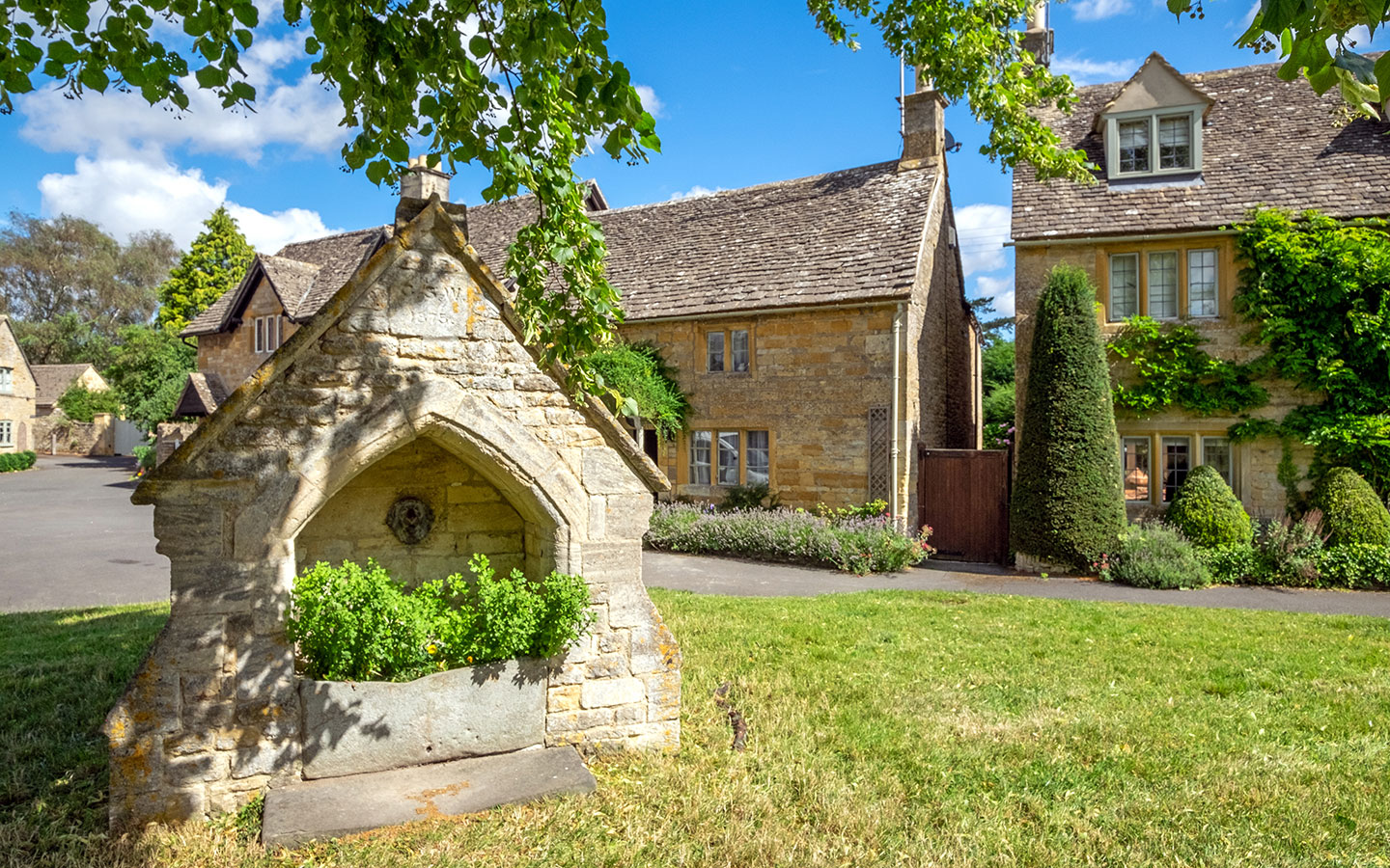 Traditional Cotswolds stone cottages when visiting Lower Slaughter