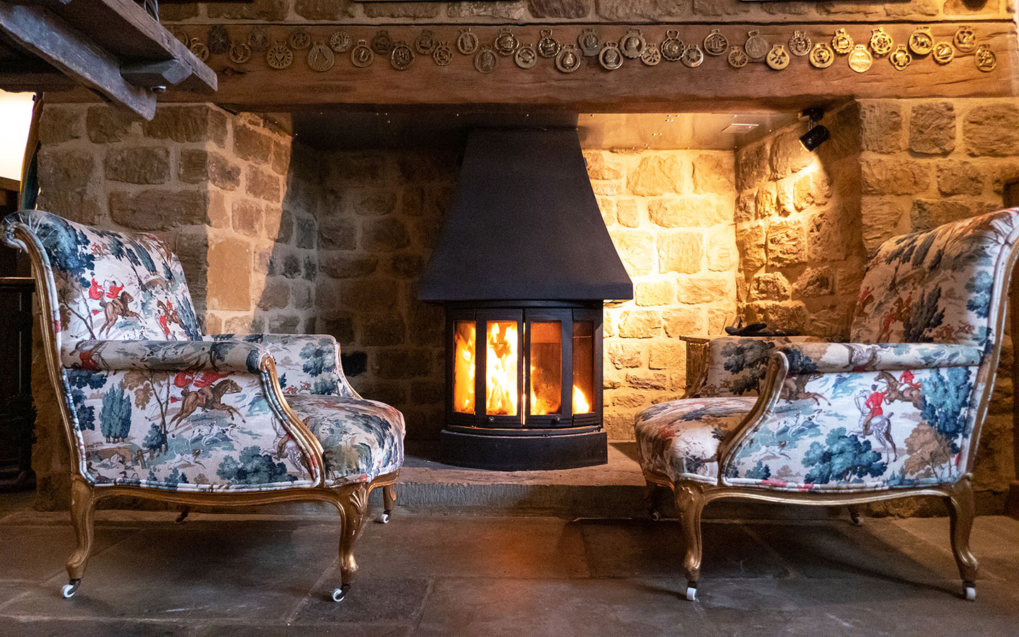 Cosying up by the fire in a Cotswold country pub in autumn